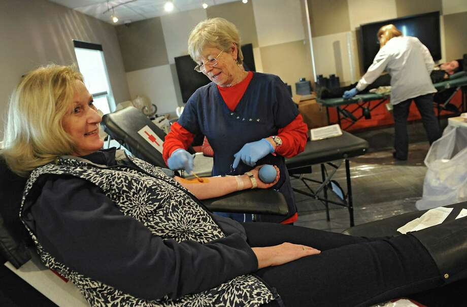 Red Cross worker Jo Schreck of Troy preps the arm of Beverly Iler of Troy as she and others donate blood in memory of Sergeant James O'Brien of the Troy Police Department at City Station apartments on Monday, Dec. 29, 2014, in Troy, N.Y. Sgt. O'Brien, 47, of Wynantskill, died Tuesday, December 28, 2010, after battling leukemia. (Lori Van Buren / Times Union) Photo: Lori Van Buren / 0029914A