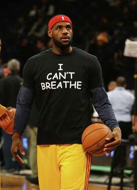"""LeBron James of the Cleveland Cavaliers wears an """"I Can't Breathe"""" shirt during warm-ups"""