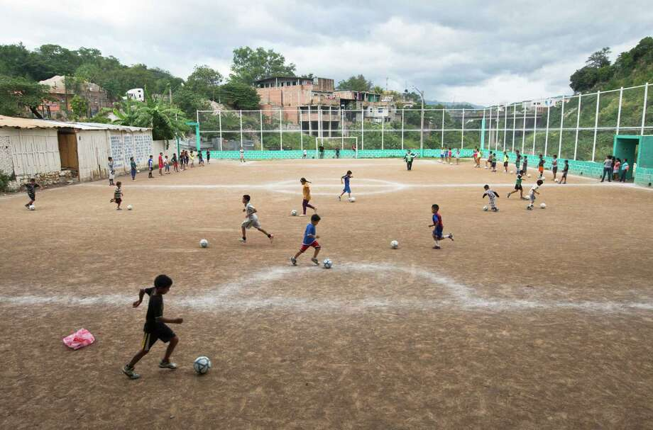 Children play soccer in the Progreso neighborhood of Tegucigalpa. A program there keeps kids from joining drug gangs. Photo: Esteban Felix / Associated Press / AP