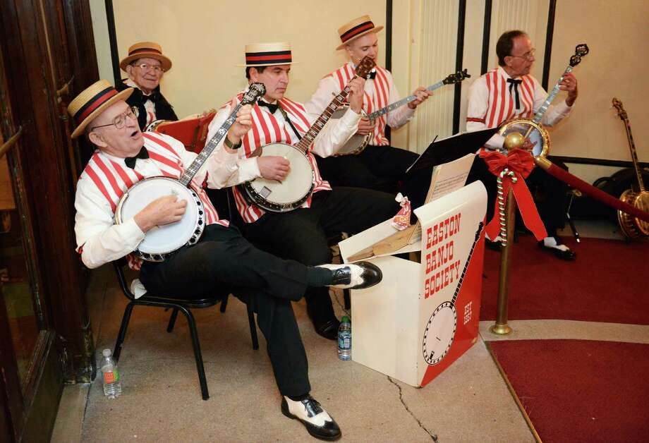 The Easton Banjo Society performs in the lobby of the Palace Theatre for First Night in Danbury, Conn. on Tuesday, Dec. 31, 2013.  The family-oriented New Years Eve happening took place in several locations in downtown Danbury, including events like music, arts and crafts, magic and games. Photo: Tyler Sizemore / The News-Times
