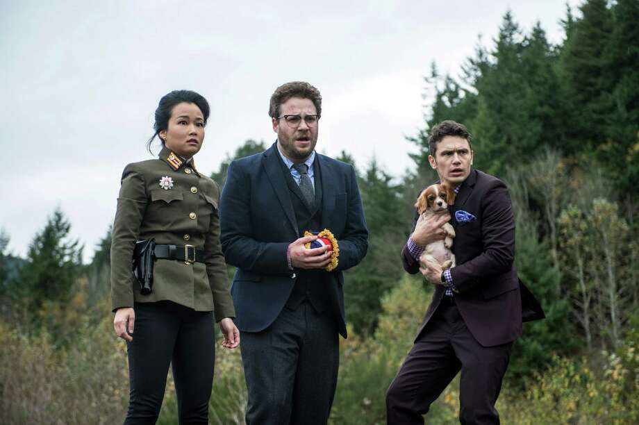 "This photo provided by Columbia Pictures — Sony shows, from left, Diana Bang, as Sook, Seth Rogen, as Aaron, and James Franco, as Dave, in Columbia Pictures' ""The Interview."" Photo: Ed Araquel / Associated Press / Columbia Pictures - Sony"