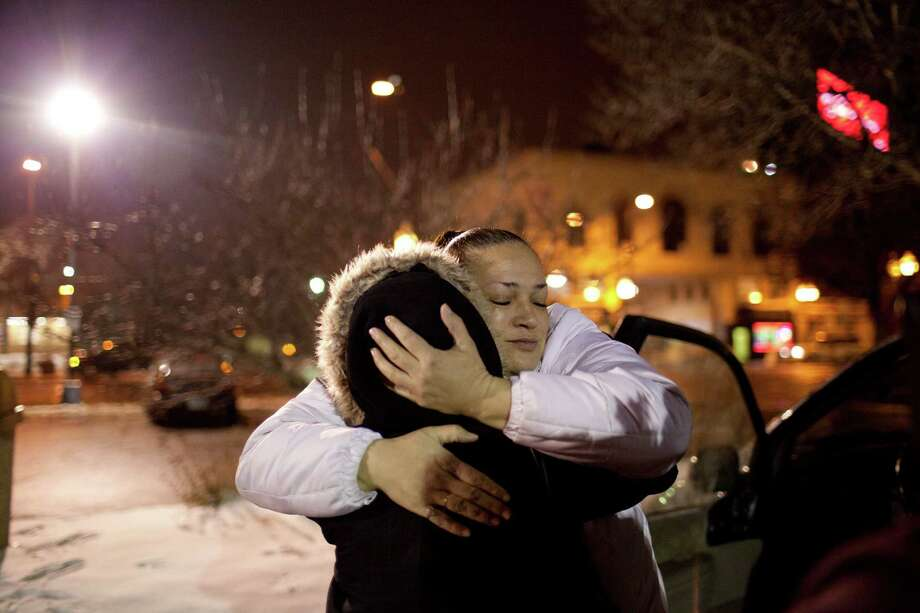 A program manager at Breaking Free — a non-profit in St. Paul, Minn., that helps women who want to leave the sex trade — hugs a woman who was working as a prostitute.  In this Jan 25, 2012 photo, Joy Friedman hugs a woman named Lisa who was working as a prostitute in Minneapolis. Friedman is a women's programs manager for Breaking Free, a St. Paul based non-profit that helps women who want to leave the sex trade. Minnesota has become a national model for combating sex trafficking, particularly with its investment of state funds to support the victims. Photo: Jeff Wheeler / Associated Press / The Star Tribune