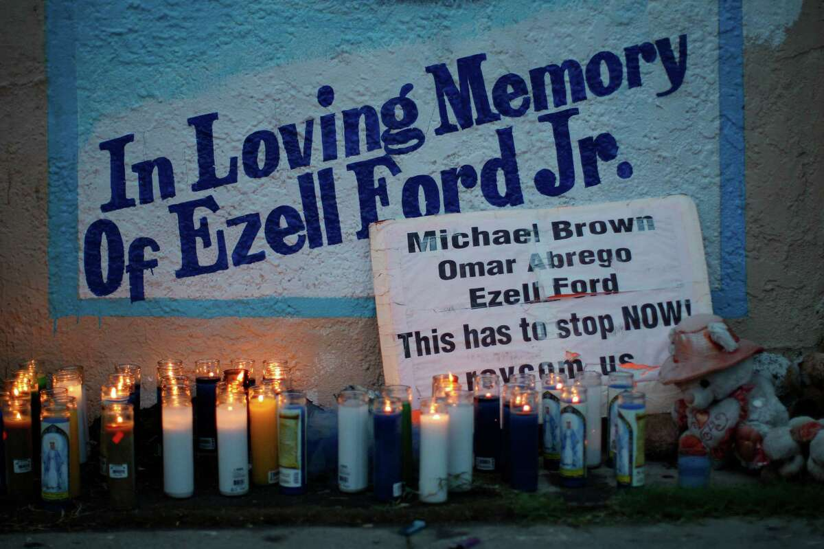 Candles burn at a memorial for Ezell Ford on Dec. 5, 2014 in Los Angeles. Ford, who had been diagnosed with depression, schizophrenia and bipolar disorder, had been reportedly unarmed when shot and killed by police on Aug. 11. Protesters marched in reaction to the decision in New York not to indict a police officer involved in the choke-hold death of Eric Garner. The decision follows a similar ruling last week in which police officer Darren Wilson was not indicted in the shooting death of unarmed black teenager Michael Brown in Ferguson, Mo. Those protests resulted in hundreds of arrests in Los Angeles.