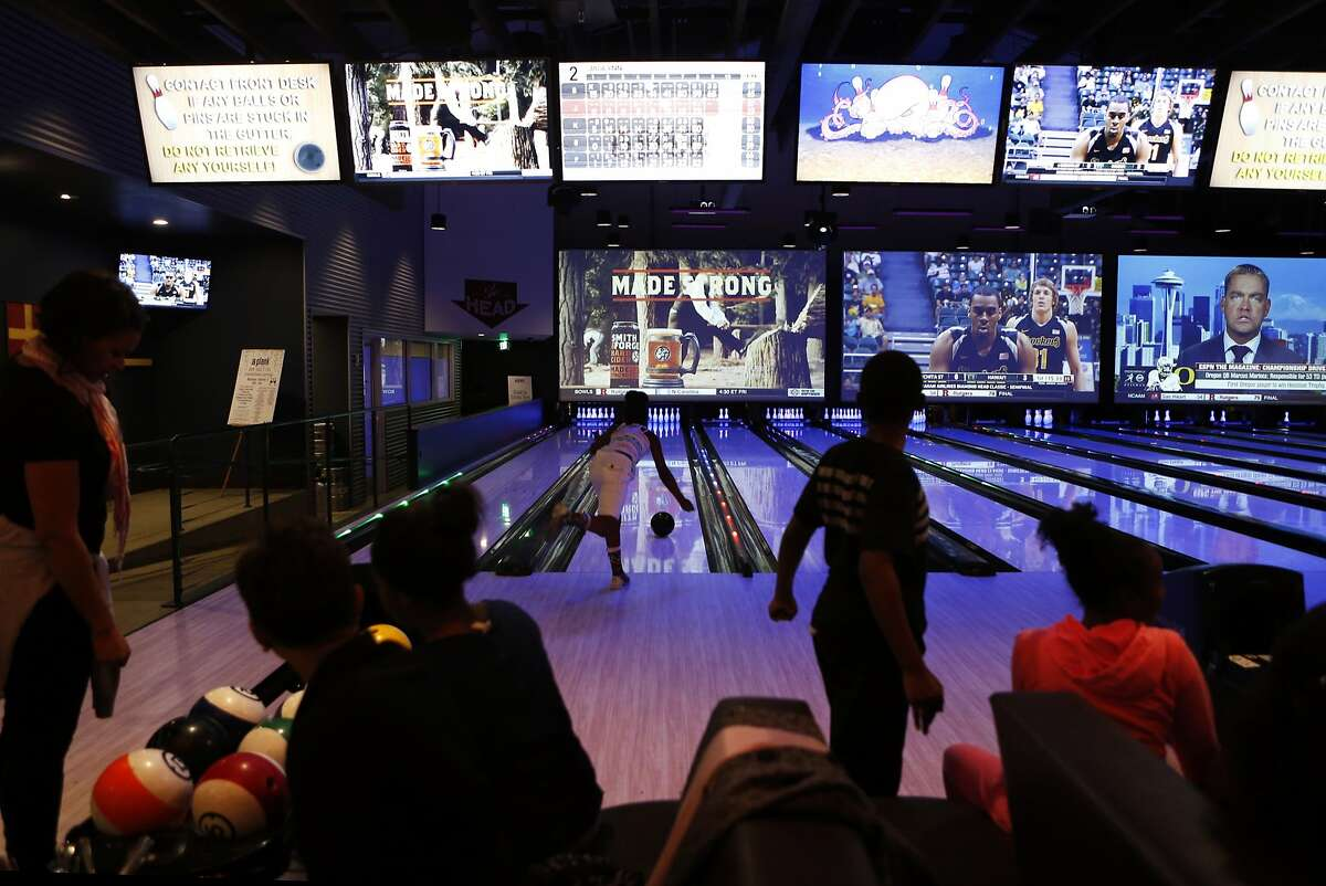 Jaclynn Gibbs, 10, of Oakland bowls at Plank in Oakland, Calif., on Tuesday, December 23, 2014. Plank is new restaurant, beer garden and entertainment concept, featuring bowling, bocce and arcade games, located in Jack London Square.