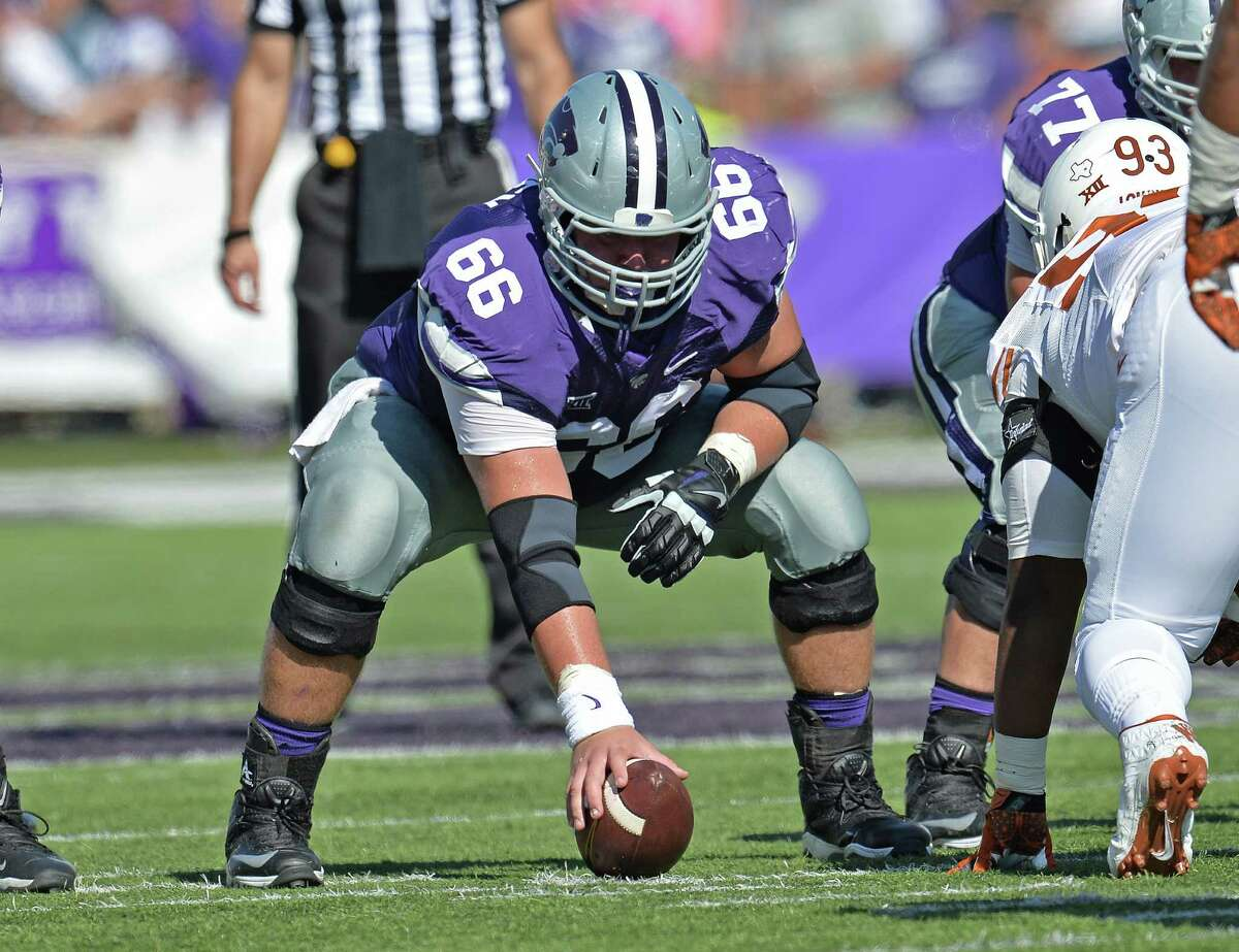 7. NFL size Kansas State center B.J. Finney is a four-year starter and is the fifth ranked center in the draft by CBS Sports and other outlets. He is projected to go in the fourth or fifth round. Photo: Kansas State center B.J. Finney gets set to snap the ball against the Texas Longhorns during the second half on Oct. 25, 2014, at Bill Snyder Family Stadium in Manhattan, Kansas.