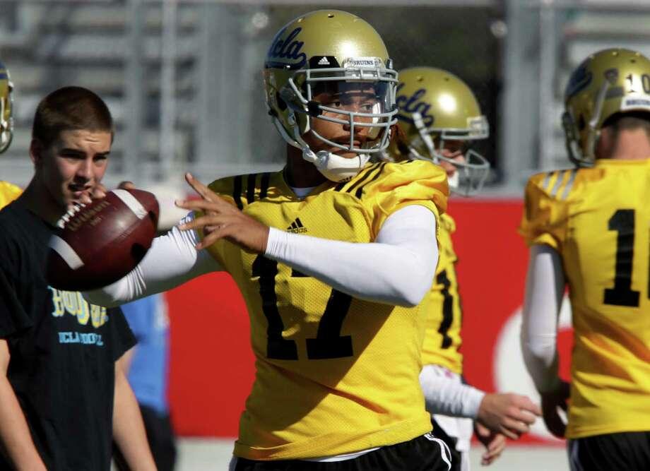 Quarterback Brett Hundley leads UCLA into Friday's Valero Alamo Bowl matchup with Kansas State. Photo: Bob Owen /San Antonio Express-News / © 2014 San Antonio Express-News