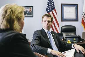 Congressman Eric Swalwell, right, talks with Alameda County District Attorney Nancy O'Malley, left, during a meeting at Congressman Swalwell's office on Feb. 4, 2014 in the Cannon Building in Washington, D.C.