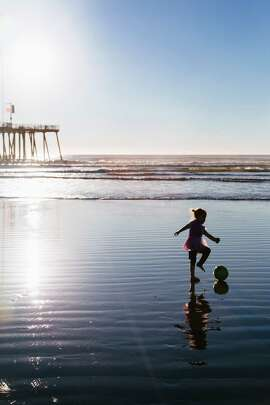 Ruthawna Collins, 4, of Forsyth, Mo., plays along the shore of Pismo Beach in December. It was her first visit to a beach. Winter can be a great time to explore the region's beaches.