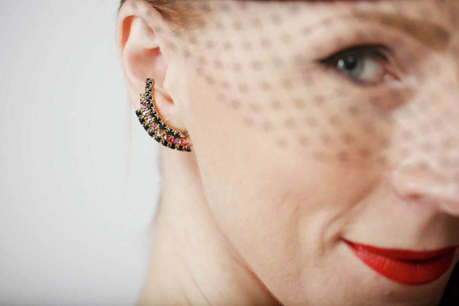 Doris Hobbs wears earrings found in a Pleasanton antiques mall and a hat from her boyfriend's grandmother. Photo: Mike Kepka / The Chronicle / ONLINE_YES