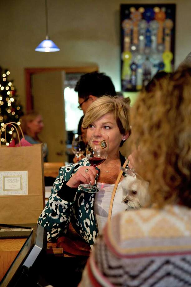 Sandra Pedigo-Marshall of Seattle samples wine at the Claiborne & Churchill Vintners, which produces 10,000 cases a year. Photo: Kendrick Brinson / ONLINE_YES