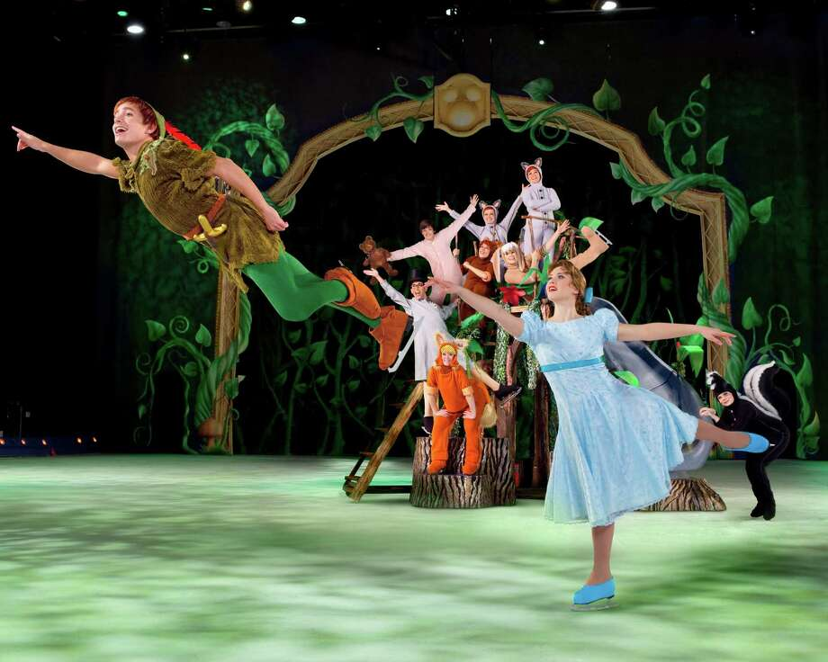"Scottish skater Luis Douglas is Peter Pan, left, in Disney on Ice's ""Treasure Trove,"" which will play Thursday through Sunday, Jan. 8-11, at the Webster Bank Arena in Bridgeport. Photo: Contributed Photo / Connecticut Post Contributed"