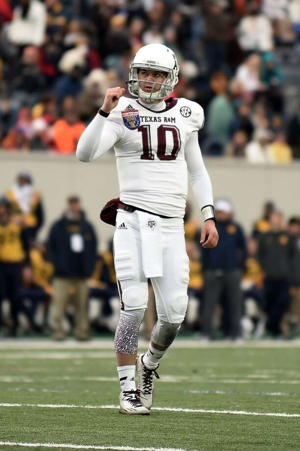 MEMPHIS, TN - DECEMBER 29:  Kyle Allen #10 of the Texas A&M Aggies reacts to a touchdown against the West Virginia Mountaineers during the third quarter of the 56th annual Autozone Liberty Bowl at Liberty Bowl Memorial Stadium on December 29, 2014 in Memphis, Tennessee.  (Photo by Stacy Revere/Getty Images) Photo: Stacy Revere, Getty Images