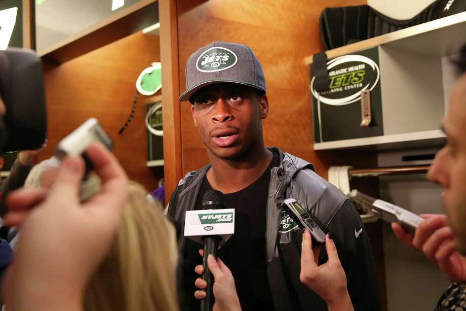 New York Jets quarterback Geno Smith speaks to reporters in the locker room after news that his coach and general manger were fired from the team, at the Atlantic Health Training Center in Florham Park, N.J., Dec. 29, 2014. Jets owner Woody Johnson fired Head Coach Rex Ryan and General Manager John Idzik Monday, a day after the Jets finished their worst season since 2007. (Chang W. Lee/The New York Times) ORG XMIT: XNYT17 Photo: CHANG W. LEE / NYTNS