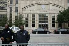 Protestors and members of the Jordan Baker family protest in front of the Harris County Criminal Courthouse on Monday, December 29, 2014 in Houston,TX. Police surrounded the criminal and civil courthouses with barricades.
