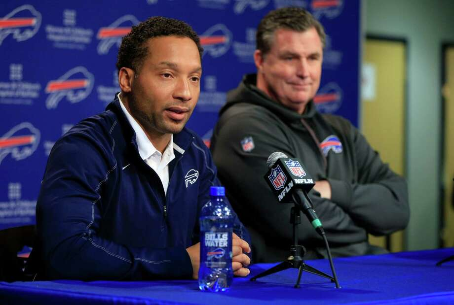 Buffalo Bills general manager Doug Whaley, left, and head coach Doug Marrone attend a news conference at Ralph Wilson Stadium in Orchard Park, N.Y., Monday, Dec. 29, 2014. Quarterback Kyle Orton told the Buffalo Bills on Monday that he plans to retire. (AP Photo/The Buffalo News, Harry Scull Jr.)  TV OUT; MAGS OUT; MANDATORY CREDIT; BATAVIA DAILY NEWS OUT; DUNKIRK OBSERVER OUT; JAMESTOWN POST-JOURNAL OUT; LOCKPORT UNION-SUN JOURNAL OUT; NIAGARA GAZETTE OUT; OLEAN TIMES-HERALD OUT; SALAMANCA PRESS OUT; TONAWANDA NEWS OUT ORG XMIT: NYBUE307 Photo: Harry Scull Jr. / The Buffalo News