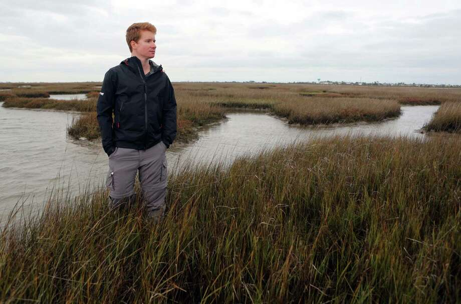Nathan Johnson, Habitat and Stewardship Program Manager at Artist Boat Inc., walks through the wetland area of the Gulf Coast Preserve that has been acquired by Artist Boat Inc. with a help of a grant on Tuesday, Dec. 23, 2014, in Galveston. , The 600 acres of preserve habitat will be protected from development on Galveston Island. ( Mayra Beltran / Houston Chronicle ) Photo: Mayra Beltran, Staff / © 2014 Houston Chronicle