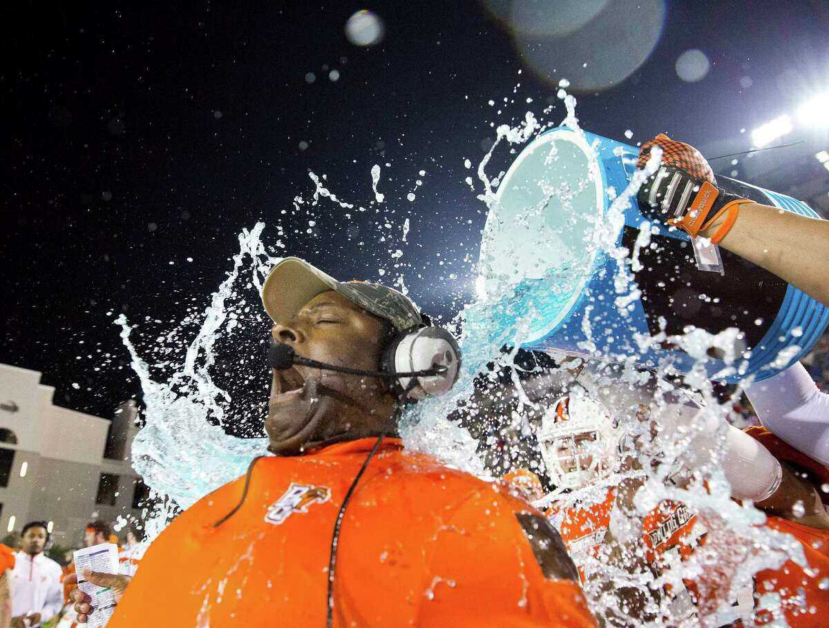 Coach Dino Babers is dunked by players after Bowling Green won the Camellia Bowl against South Alabama last week. A reader says with so many bowl games nowadays, he's thinking of turning to sitcoms this season.