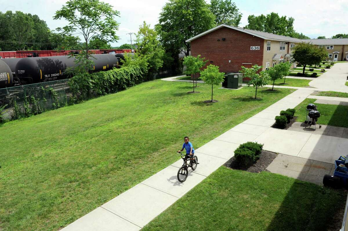 View of the courtyard between the apartment buildings and the rail line that carries oil tankers to the Port of Albany Wednesday, July 16, 2014, at Ezra Prentice Homes in Albany, N.Y. (Cindy Schultz / Times Union)