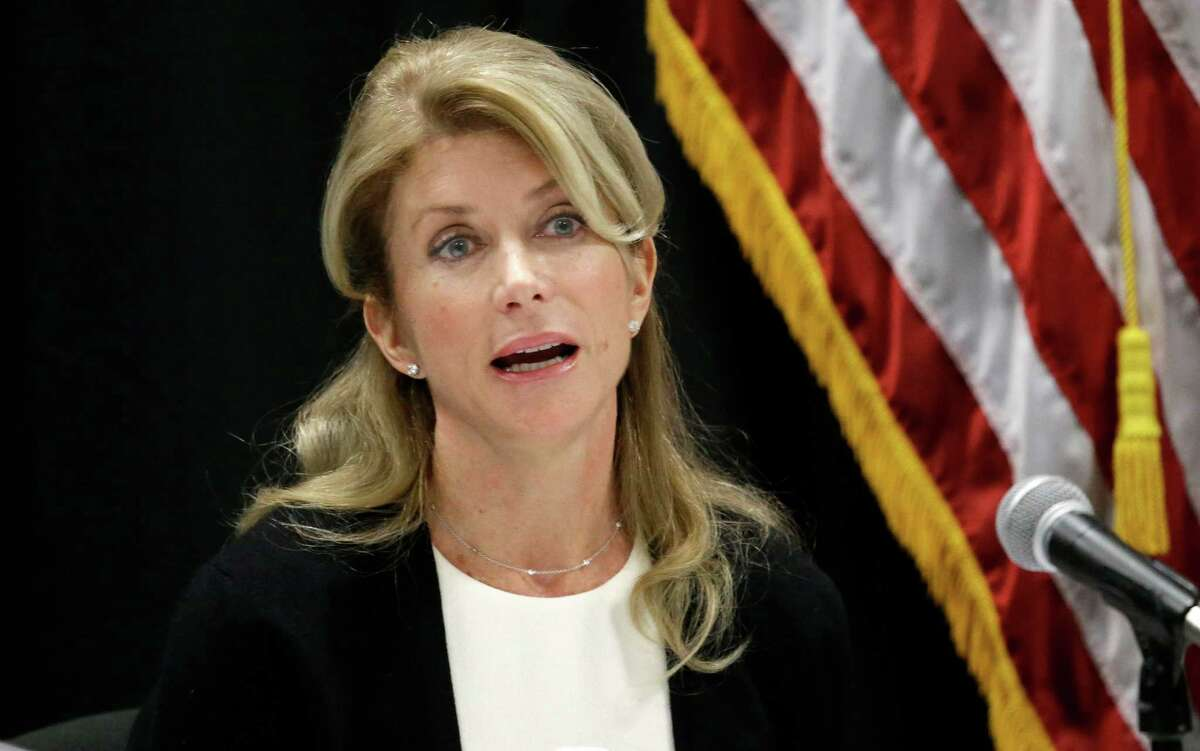 In this Jan. 9, 2014 file photo, Texas Sen. Wendy Davis speaks at an education roundtable meeting in Arlington, Texas. Davis, who has said she would support expanding gun rights, now says that includes allowing concealed handgun license holders to openly carry their weapons in public. (AP Photo/LM Otero, File)