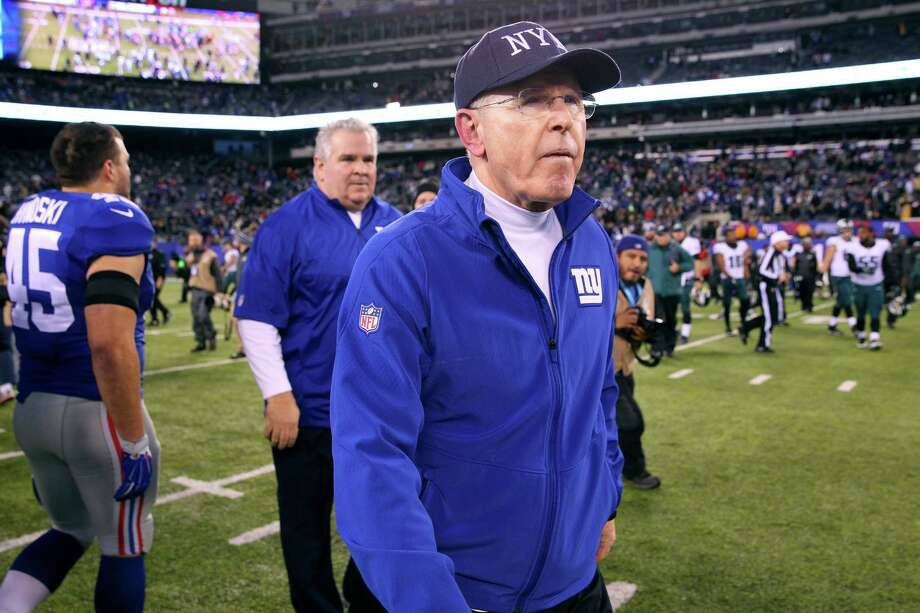 New York Giants head coach Tom Coughlin leaves the field after losing to the Philadelphia Eagles at MetLife Stadium in East Rutherford, N.J., Dec. 28, 2014. (Chang W. Lee/The New York Times) ORG XMIT: XNYT86 Photo: CHANG W. LEE / NYTNS