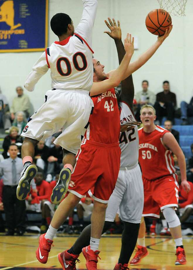 Niskayuna's Anthony Fragnoli, #42, drives to the basket between Schenectady's Roddy Delagrandeanse, #00, and Todd Spottswood, #42, during a basketball game in the Hilliard Tournament on Monday, Dec. 29, 2014 in Schenectady, N.Y.  (Lori Van Buren / Times Union) Photo: Lori Van Buren / 00029997A