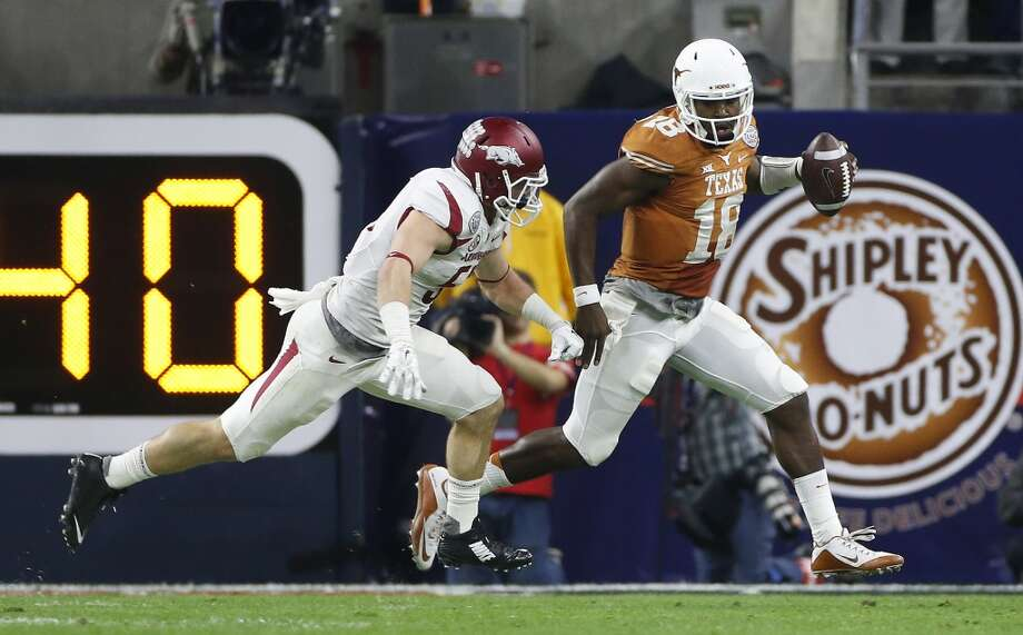 AdvoCare Texas Bowl (Dec. 29): Arkansas 31, Texas 7  Record: 6-7 Texas quarterback Tyrone Swoopes (18) runs to avoid the tackle of Arkansas linebacker Brooks Ellis (51) during the first quarter of the AdvoCare V100 Texas Bowl at NRG Stadium, Monday, Dec. 29, 2014, in Houston. ( Karen Warren / Houston Chronicle  ) Photo: Karen Warren, Houston Chronicle