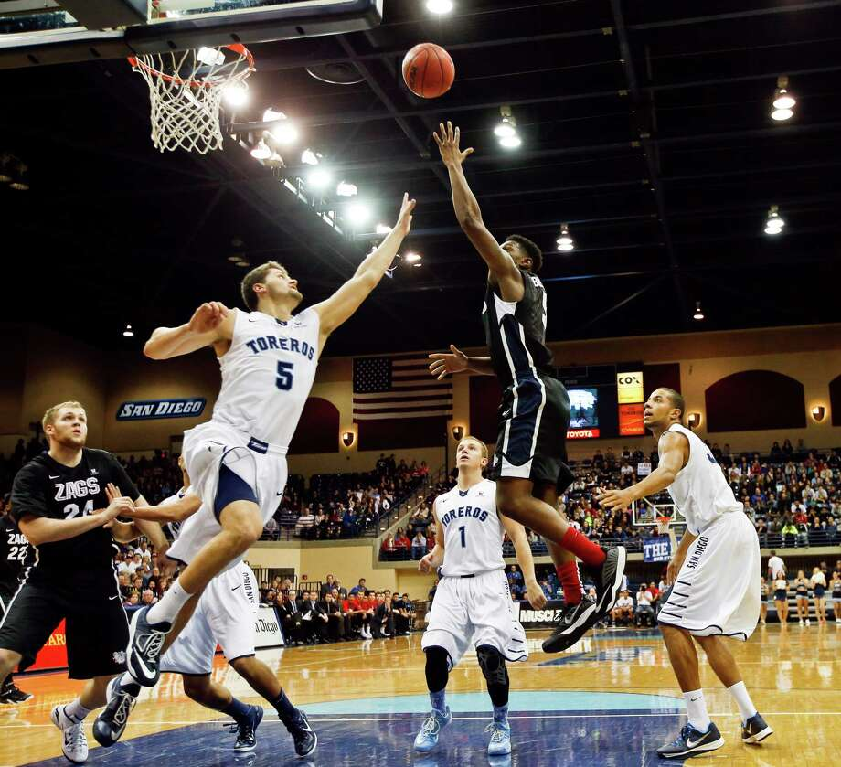 Gonzaga guard Gary Bell Jr. shoots over San Diego's Thomas Jacobs. Photo: Lenny Ignelzi / Associated Press / AP
