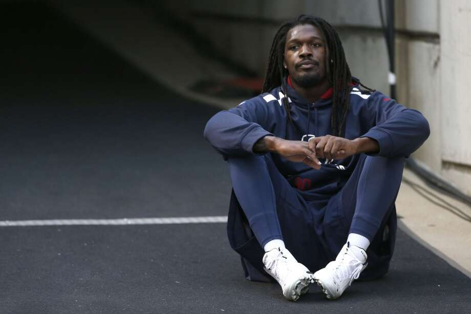 Jadeveon Clowney wasn't talking about his game-turning penalty while inactive on the sideline during Sunday's loss to the Titans. Photo: Karen Warren, Houston Chronicle