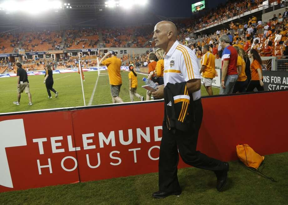 10. Kinnear leaves DynamoAfter building a dynasty over nine seasons in Houston, coach Dominic Kinnear's departure proved to be the biggest story of the Dynamo's disappointing year. The 2014 season for the Dynamo was defined by losses as the club missed the playoffs for only the second time in franchise history and the first since 2010. Kinnear led the Dynamo to two MLS Cup titles and four finals with a rugged defensive style, but he jumped at the chance to head back home to San Jose to coach the Earthquakes next season. The Dynamo recently hired former English Premier League coach Owen Coyle, promising to play a more attacking style in 2015. Photo: Karen Warren, Houston Chronicle