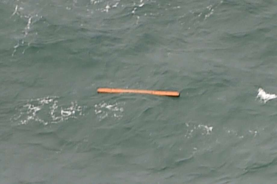 This aerial view taken from an Indonesian search and rescue aircraft over the Java Sea shows floating debris spotted in the same area as other items being investigated by Indonesian authorities as possible objects from missing AirAsia flight QZ8501 on December 30, 2014.  Items resembling an emergency slide, plane door and other objects were spotted during a aerial search on December 30 for the missing AirAsia plane, according to information from the flight on which AFP was aboard.    AFP PHOTO / Bay ISMOYOBAY ISMOYO/AFP/Getty Images Photo: Bay Ismoyo, AFP/Getty Images