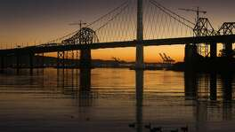 Geese swim past the new eastern span of the Bay Bridge in Clipper Cove at daybreak in San Francisco, Calif. on Tuesday, Dec. 23, 2014.