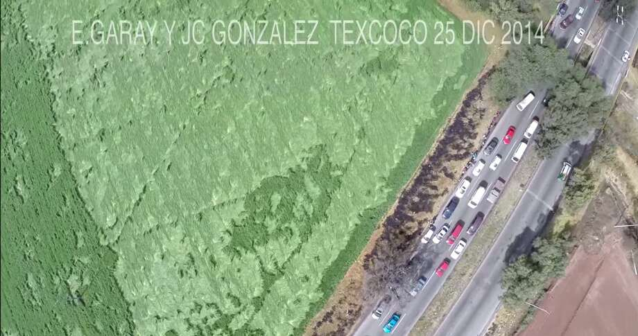 Hundreds of people have apparently made a pilgrimage to the Mexican municipality of Texcoco to investigate mysterious crop patterns that supposedly appeared in a barley field on Christmas Eve. Photo: Fechter, Joshua I, Screenshot Via YouTube
