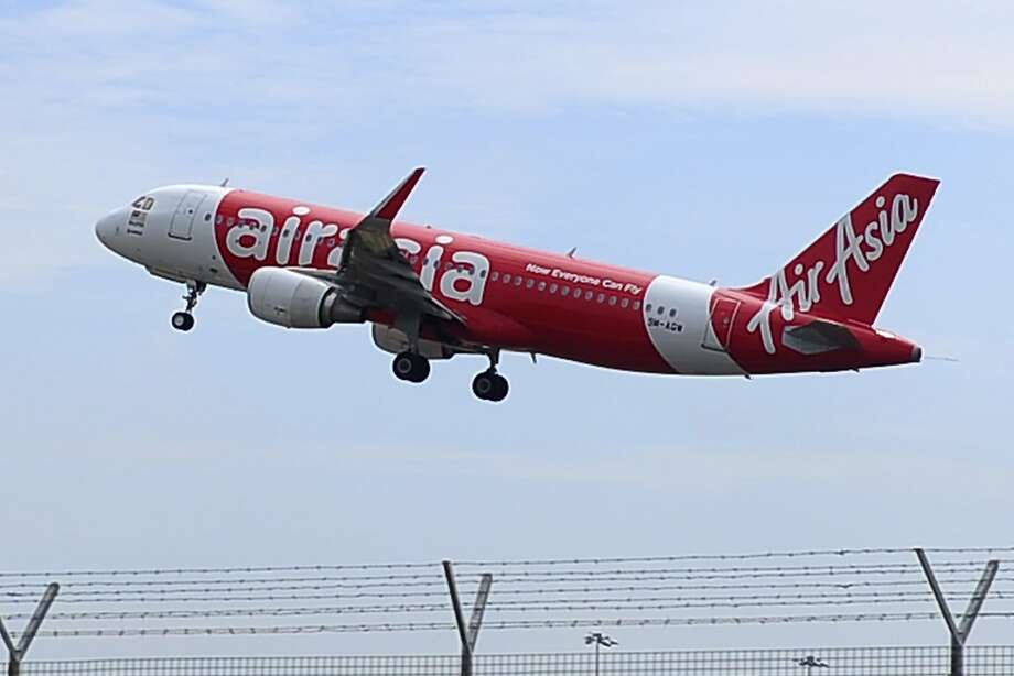 In this May 9, 2014 photo, an AirAsia A320-200 plane takes off from Kuala Lumpur International Airport 2 in Sepang, Malaysia. Photo: Joshua Paul, Associated Press