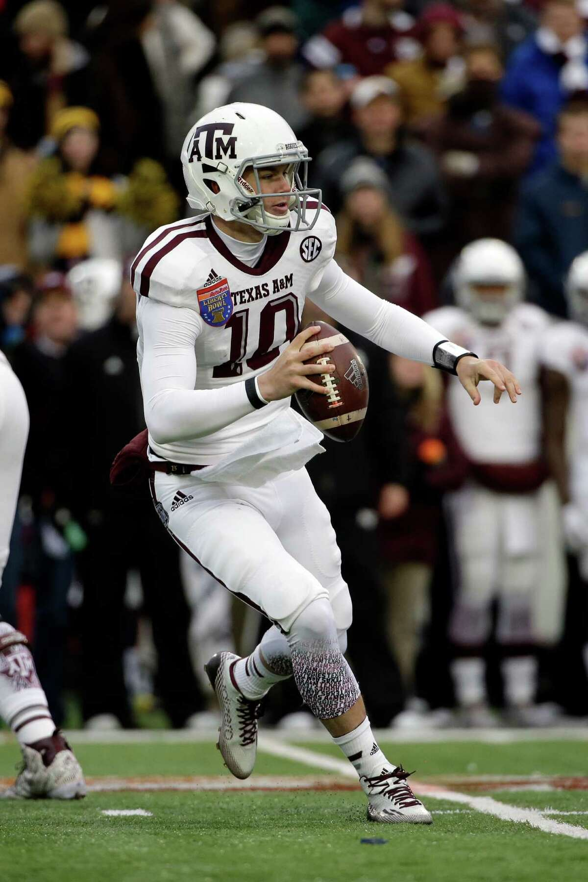 Texas A&M quarterback Kyle Allen (10) plays against West Virginia in the second half of the Liberty Bowl NCAA college football game Monday, Dec. 29, 2014, in Memphis, Tenn. Texas A&M won 45-37.