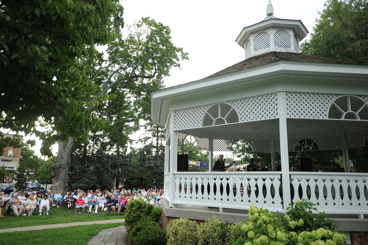 The author's gratitude begins with appreciation for the town where he's chosen to remain in retirement. Here, residents gather for a summer concert on Sherman Green.