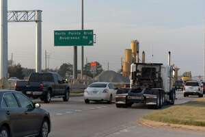 Local signage leads SH 249 north bound traffic to the North Pointe and Boudreaux intersections.