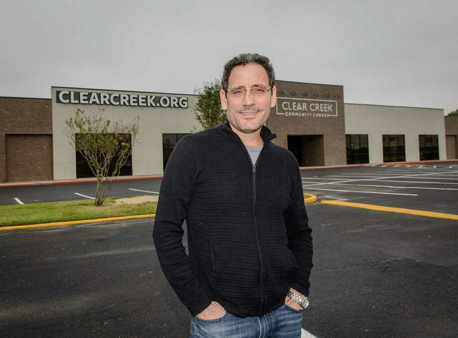 Karl Garcia, campus pastor, stands in front of the exterior of Clear Creek Community Church-Clear Lake Campus, located in a former bowling alley. Photo: ÂKim Christensen, Photographer / ©Kim Christensen