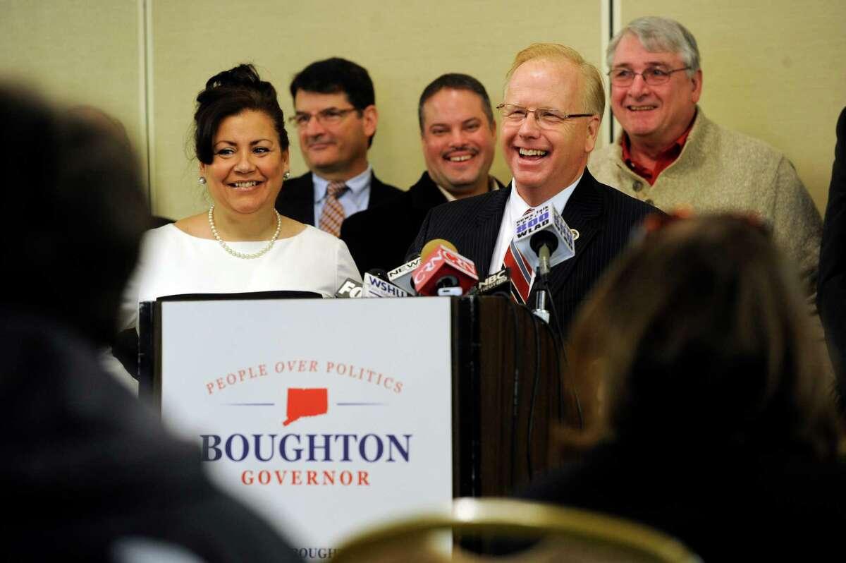 Danbury Mayor Mark Boughton, with his wife Phyllis at his side, and Danbury City Council standing behind him, annouces his intention to run for the governor, Wednesday, January 8, 2014.
