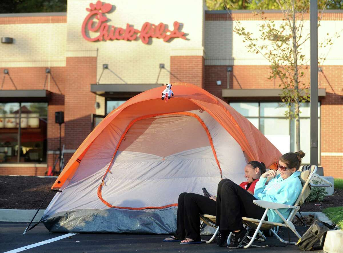 Customers camp out in front of the Chick-fil-A in Brookfield, Conn., to be among the first 100 diners and be awarded a free meal once a week for a year, Wednesday, Oct. 8, 2014. The restaurant is opening at 6:30 am tomorrow Oct. 9, 2014 and is the first in the state.