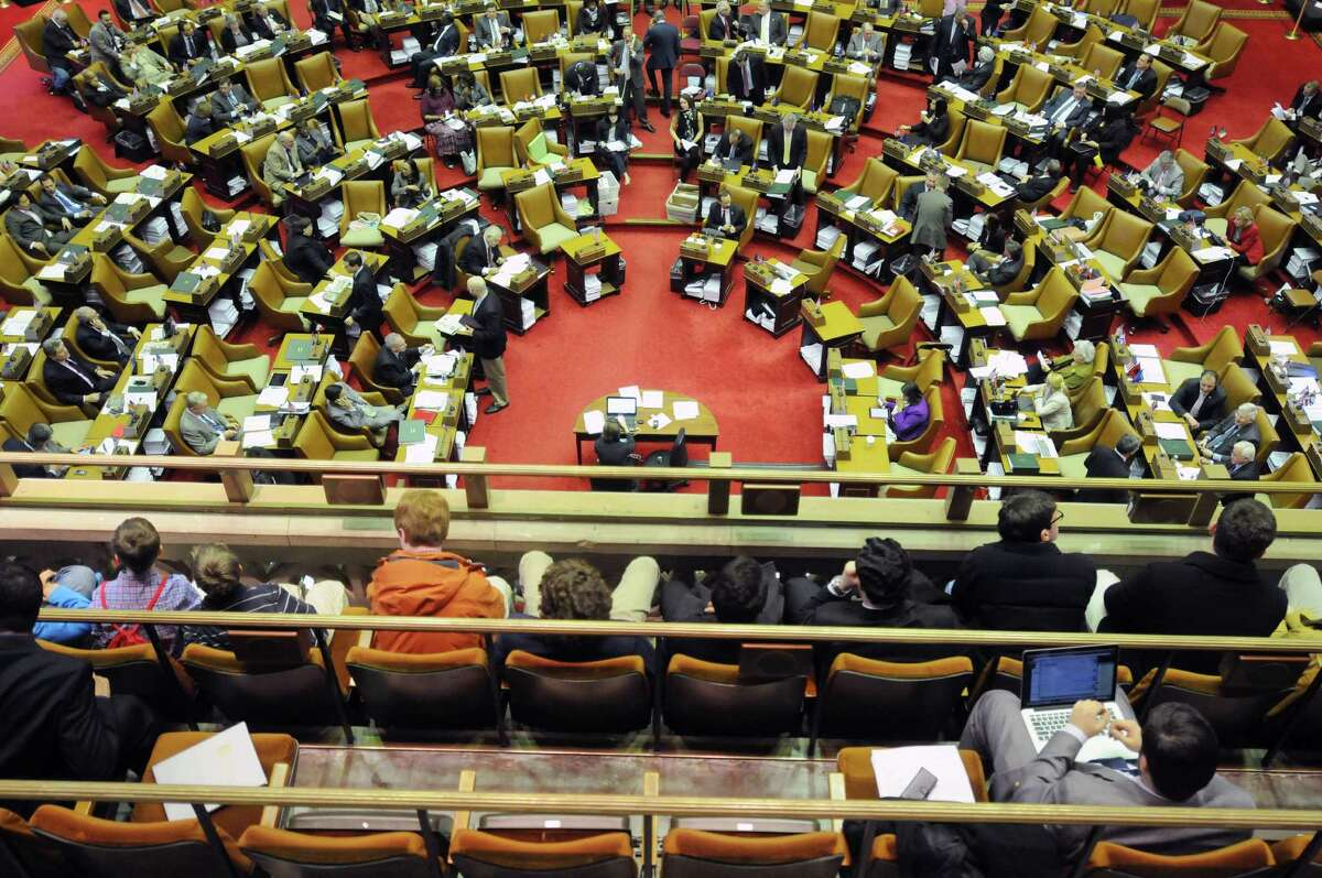 Visitors in the gallery watch as members of the New York State Assembly take part in a session on Thursday, March 27, 2014, in Albany, N.Y. (Paul Buckowski / Times Union)