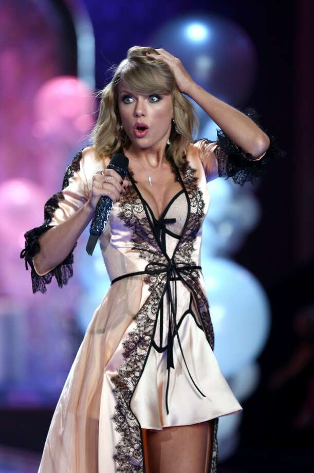 Taylor Swift performs on the runway at the annual Victoria's Secret fashion show at Earls Court on December 2, 2014 in London, England. Photo: Tim P. Whitby, Getty Images