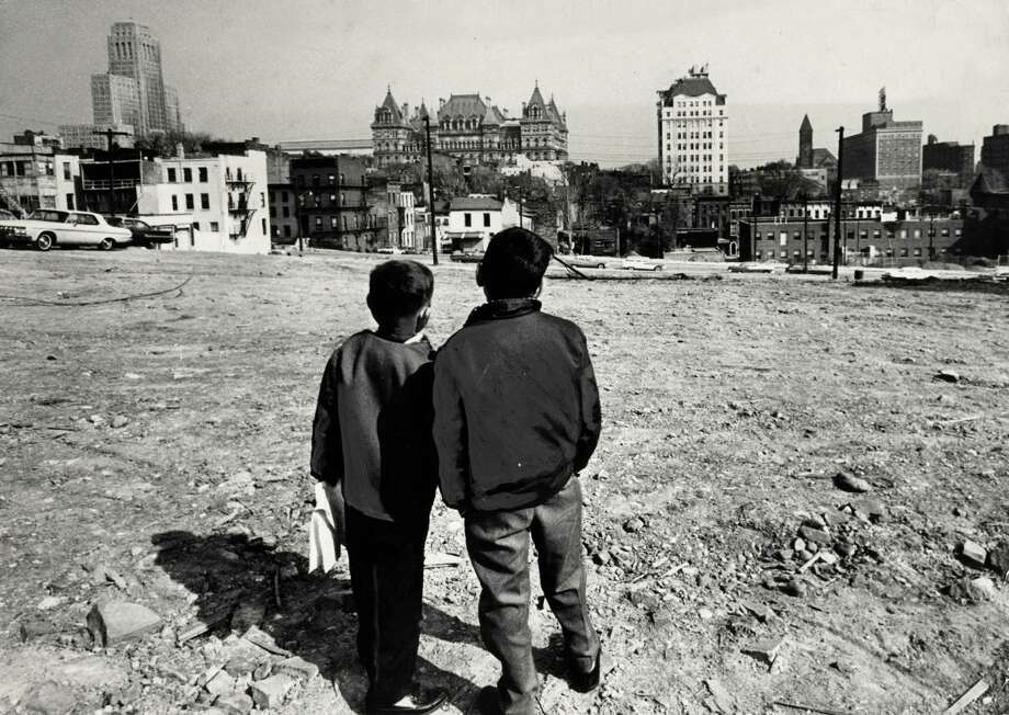 Two boys view a demolished block for construction of the South mall near the Cathedral of the Immaculate Conception Oct. 22, 1963, in Albany, N.Y. Historic Empire State Plaza, South Mall. (Times union archive)