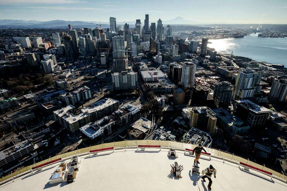 High above the city, crews from Pyro Spectaculars and the Space Needle work to install several thousand pyrotechnic shots for the upcoming, eight-minute T-Mobile New Year's fireworks display, photographed Tuesday, in Seattle. Photo: JORDAN STEAD, SEATTLEPI.COM / SEATTLEPI.COM