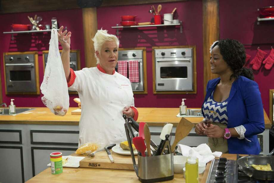 "Kortni Montgomery, right, gets a lesson from chef Anne Burrell on the sixth season of ""Worst Cooks in America."" The show's new season begins airing Jan. 4. Photo: Food Network / ONLINE_YES"