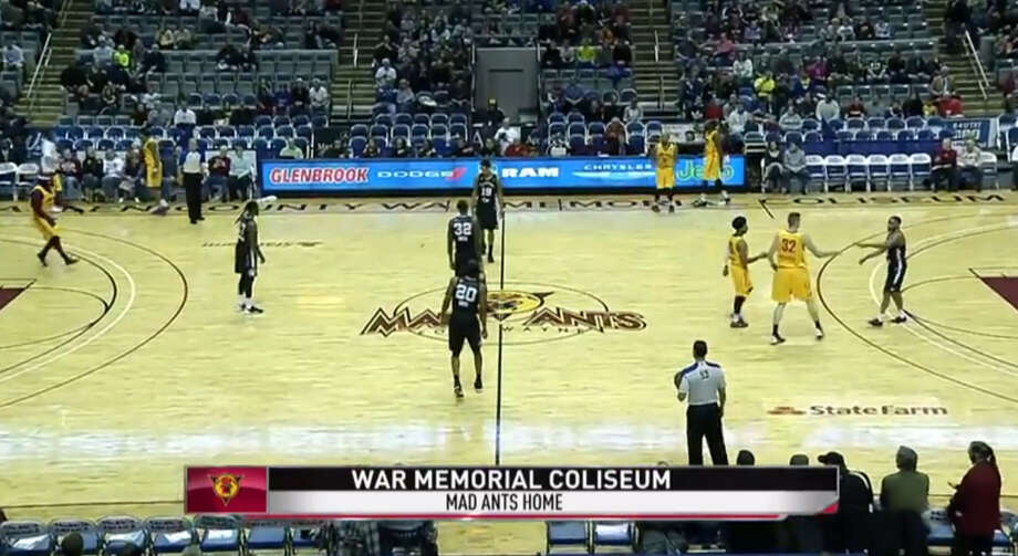 The Austin Spurs and Fort Wayne Mad Ants players watch as a bat (the small black dot to the left of No. 32, JaMychal Green) flies down the middle of the court on Sunday, Dec. 28, 2014, in Fort Wayne, Indiana. Photo: Screenshot From NDN Via YouTube