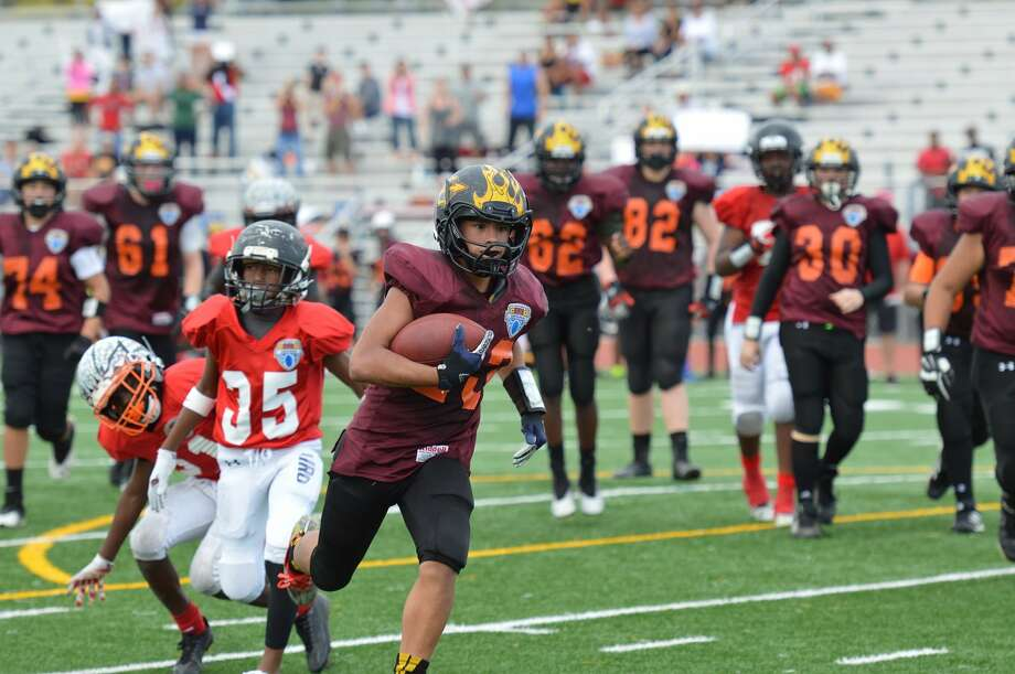 A Houston area squad of sixth-graders, led by running back Casey Shorter, above, took top honors at the Football University national championship with a 36-20 win over Broward County (FL). Photo: Special To The Chronicle / Handout