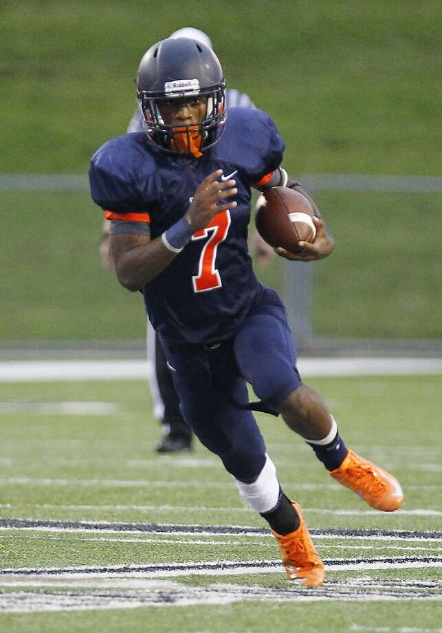 Braeden West of Seven Lakes finds some daylight as the Spartans took on Tompkins at Rhodes Stadium in Katy on September 27, 2014. Photo: Diana L. Porter, Freelance / © Diana L. Porter