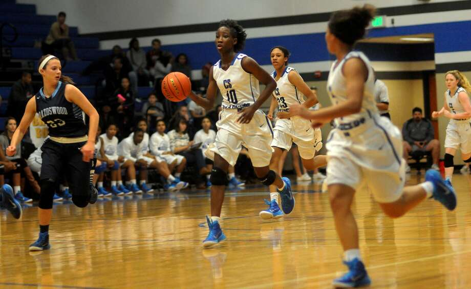 Clear Springs sophomore point guard Tarsharian Robinson (10) works the ball upcourt against Brazoswood sophomore guard Mikayla Traweek (23) during their game at Clear Springs High School on Dec. 19. Photo: Jerry Baker, Freelance