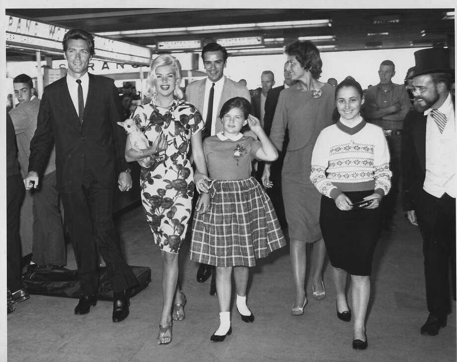 Clint Eastwood (left) and Jayne Mansfield (second from left) arrive at the 1962 Barbary Coast Fandango in San Francisco. Photo: Bob Campbell, The Chronicle
