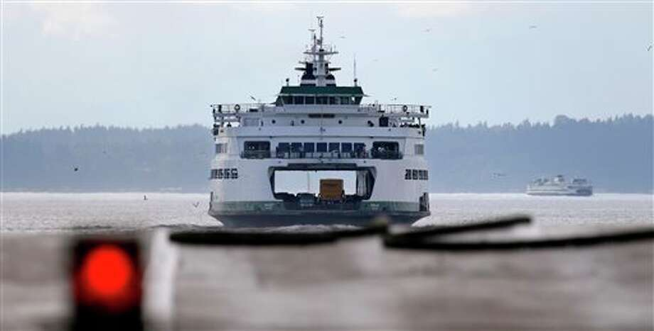 In this Wednesday, Aug. 20, 2014 photo, the ferry Puyallup departs Colman Dock in Seattle for a cross-sound trip to Bainbridge Island. Photo: Elaine Thompson, Multiple / AP